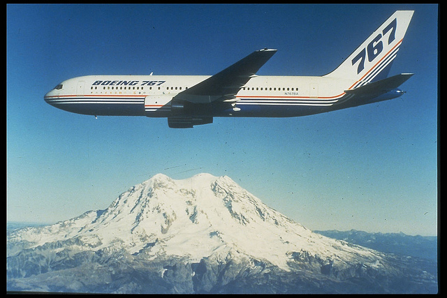 Boeing 767 flying over Mount Rainier, USA