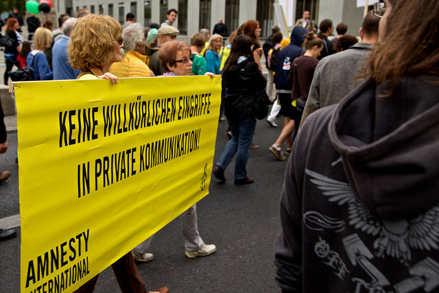 Amnesty International campaigners at a Berlin protest against mass surveillance in 2014