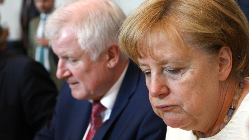 epa06802437 German Interior Minister and leader of the Social Democratic Union Horst Seehofer (L) and the Christian Democratic Union leader German Chancellor Angela Merkel (R) attend a parliamentary group meeting of the German Christian Democratic Union and the Christian Social Union, at the Bundestag in Berlin, Germany, 12 June 2018. Party members of the CDU and CSU gather for their faction meeting in a regular basis. EPA-EFE/OMER MESSINGER