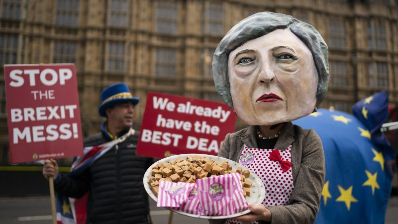 epa07221280 Anti-Brexit campaigner dressed as British Prime Minister Theresa May holding a plate of fudge poses for photographers outside Houses of Parliament in Central London, Britain, 10 December 2018. Prime Minister May faces a vote in the House of Commons tomorrow on her draft agreement with the European Union which is due to take the United Kingdom out of the European Union in March 2019. EPA-EFE/WILL OLIVER